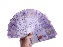 Ringgit of hundred nominal hand held Royalty Free Stock Photo