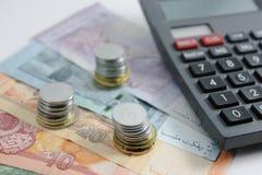 Ringgit y calculadora del billete de banco de Malasia Fotos de archivo libres de regalías