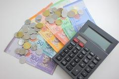 Ringgit y calculadora del billete de banco de Malasia Imagenes de archivo