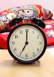 Ringing alarm clock and empty bed in background Stock Photography