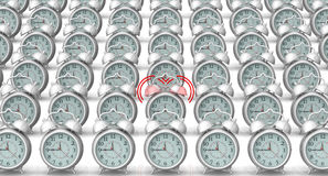 Ringing alarm clock among non-ringing. A ringing alarm clock in row of not ringing on a white surface. . 3D Illustration Royalty Free Stock Photography