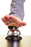 Ringing a bell. Hand over a hotel bell on a counter Stock Images