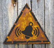 Ringing Bell Icon on Rusty Warning Sign. Royalty Free Stock Photo
