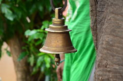 Ringing bells. A bell tied to elephant's neck Stock Photo