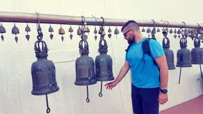 Ringing bells on Golden Mount. Caucasian tourist with beard ringing bells on Golden Mount Royalty Free Stock Photos