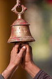 Ringing buddhist bell in nepali temple Royalty Free Stock Images
