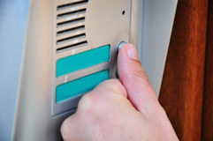 Ringing doorbell Stock Images