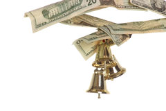 Ringing in holiday profits. Horizontal of bells ringing in holiday profits on white backdrop Royalty Free Stock Image