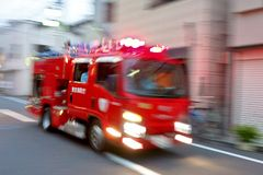 Ringing a sharp siren, fire-fighting automobile emergency dispatch to extinguish a fire. Siren is ringing, emergency dispatch of fire trucks stock images