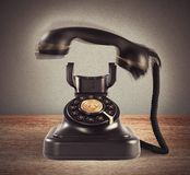 Ringing vintage phone. Image representing a ringing vintage black phone stock photo