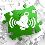 Ringing White Bell Icon on Green Puzzle. Royalty Free Stock Photos