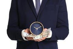 Ringklocka och kassa för affärsman hållande royaltyfria foton