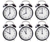 Ringklockauppsättning med händer från 7 till 12 klockan Fotografering för Bildbyråer
