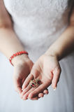Ringlet in hands Royalty Free Stock Photography