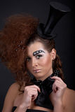 Ringmaster. Beautiful girl with funny make-up - domino, hat, and crystals Stock Image