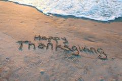 Ringraziamento felice in sabbia Fotografie Stock