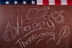 Ringraziamento felice, scritto in gesso bianco su una lavagna, Immagine Stock