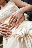 Rings. Newlyweds tenderly holding hands. Focus on rings Royalty Free Stock Photos