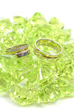 Rings. Two beautiful wedding rings with green stones Royalty Free Stock Photo