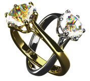 Rings. Golden and silver diamond rings locked Stock Photos
