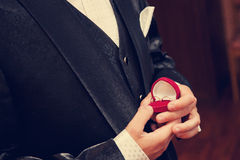 Rings. Wedding rings in the hands of the groom Stock Photo