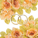 Rings. Golden rings between flowers, elegance and glamour Royalty Free Stock Image