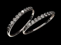Rings. Two rings with diamonds against a black background royalty free stock image