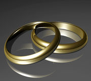 Rings. Two golden rings on grey ground Royalty Free Stock Photo