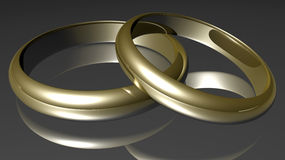 Rings. Two golden rings on grey ground Royalty Free Stock Images