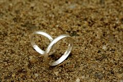 Rings. Two wedding rings in the sand Royalty Free Stock Image