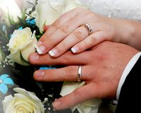 Rings. Husband and wife show their wedding rings after getting married Stock Photo