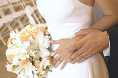 Rings. Wedding couple with rings and bouquet Stock Photo