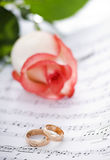 Rings. Wedding rings on note sheet close up shoot Stock Images