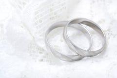 Rings. Platonic rings on white satin Stock Images