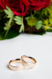 Rings besides flowers Stock Photography