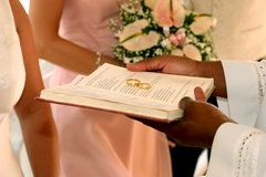 Rings on the bible. 2 wedding rings being blessed on a bible Royalty Free Stock Images