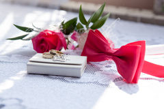Rings, bow tie and rose Royalty Free Stock Image