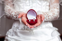 Rings with box in bride hands. Red box with rings in bride hands Royalty Free Stock Photos