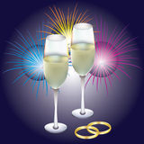 Rings, champagne and fireworks. Wedding rings, two glasses with champagne and fireworks Royalty Free Stock Photography