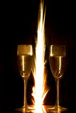 Rings in champagne glass and firework Royalty Free Stock Images