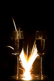 Rings in champagne glass and firework Stock Image