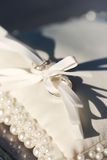 Rings on a cushion for wedding rings. Rings on a white cushion for wedding rings stock photo