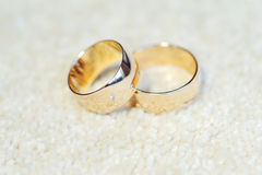 Rings with Diamond and Engraving. Two golden rings with diamond and engraving royalty free stock image