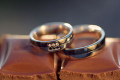 Rings with Diamonds and Chocolate Stock Image