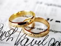 Rings on document Stock Images