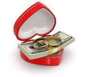 Rings and Dollars in the heart box (clipping path included) Royalty Free Stock Images