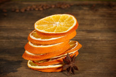 Rings of dried orange on wooden board. And star anise Royalty Free Stock Photos