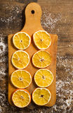 Rings of dried orange on wooden board. On tabe Royalty Free Stock Images