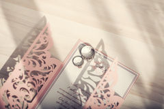 Rings  engagement and invitation on a wedding Stock Images
