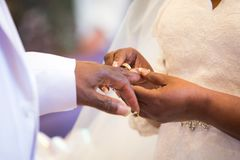Rings exchange for black couple marriage Royalty Free Stock Photos